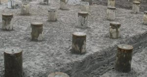 Timber pilings contractors timber pilings florida for Wood piling foundation cost